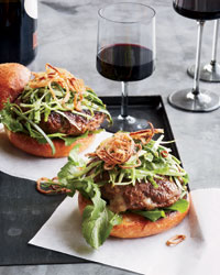 Cheddar-Stuffed Burgers with Pickled Slaw and Fried Shallots